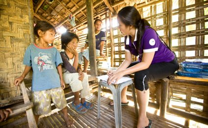 A health worker talks to